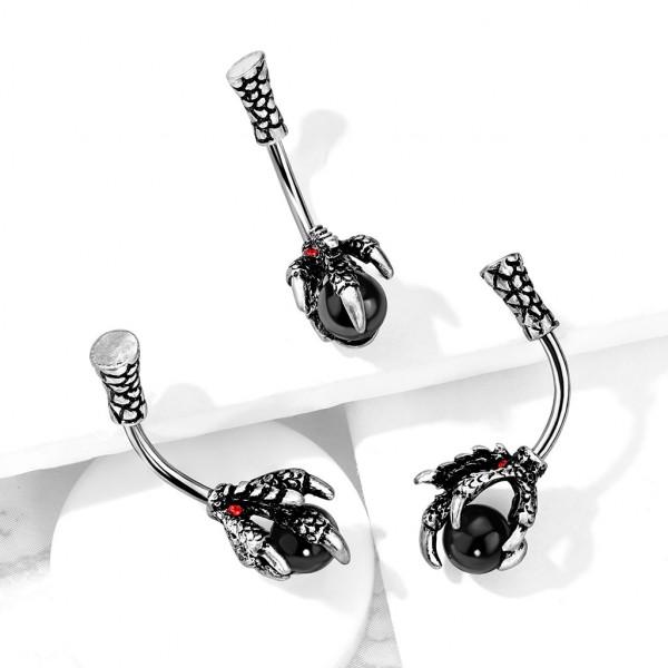 Drachenklaue mit rotem Kristall hält schwarze Kugel Bauchnabelpiercing